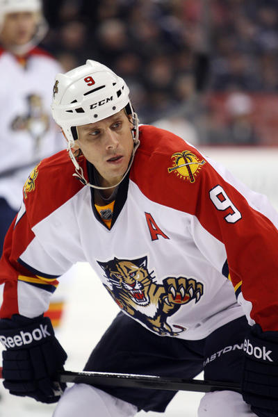 Florida Panthers forward Stephen Weiss (9) awaits face off during the third period against the Winnipeg Jets at the MTS Centre. Winnipeg won 3-2.