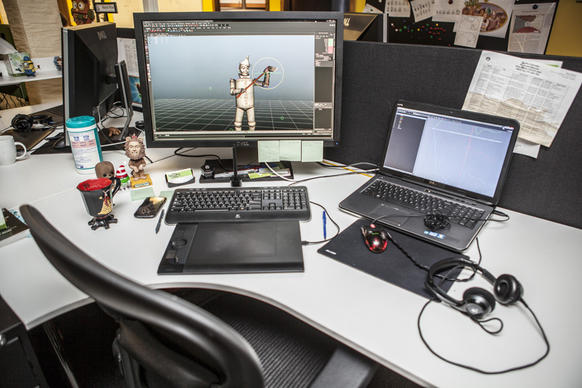 A work space at Spooky Cool Labs displays motion work being done on the Tin Man for