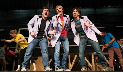 "Atholton seniors, from left, Michael Thalheimer, Spencer Franco and Jay Nachenberg rehearse a scene from ""The Wedding Singer"" at Atholton High School."