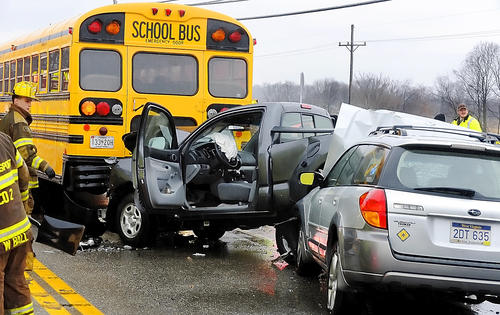A pickup truck was partially trapped beneath a school bus on Lappans Road at Lock Tender Lane, about three miles southeast of Williamsport, officials said.