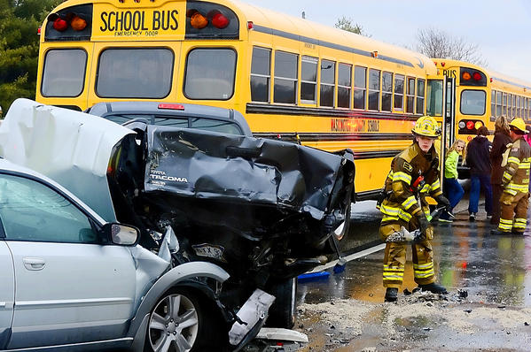 A student looks back at the damage after the school bus she was riding in was involved in an accident with two other vehicles on Lappans Road (Md. 68) Tuesday afternoon.