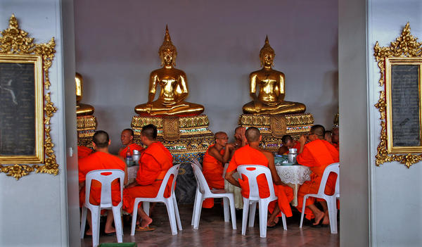 Monks pause for lunch in Bangkok, Thailand.