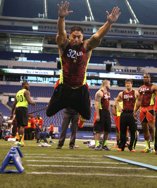 Notre Dame linebacker Manti Te'o does the broad jump during the NFL combine.