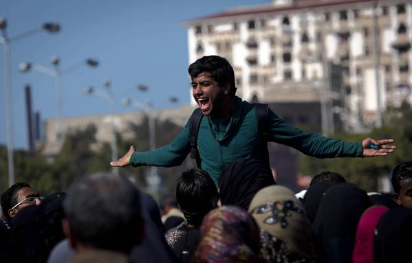 An Egyptian chants slogans last week against President Mohamed Morsi while leading a rally during a general strike in Port Said, Egypt.
