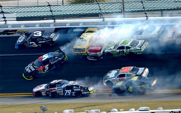 Michael Annett, in the yellow car, was injured in a multiple-car crash late in the race.