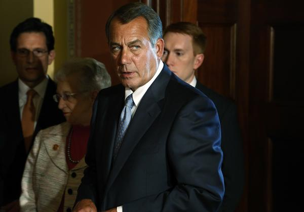 House Speaker John Boehner prepares to take the lectern at a news conference Monday with fellow House Republican leaders.