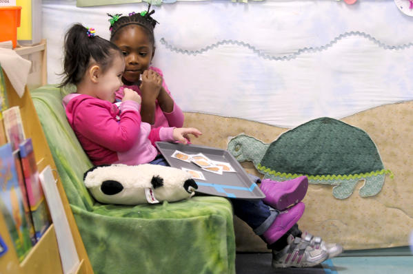 Bella Mattson, 3, (from left) and Dajah Brown, 4, both of Hartford entertain themselves during Discovery Time in their preschool classroom at CRT on Locust Street in Hartford on Tuesday morning. The state has sunk hundreds of millions of dollars into preschool but, despite calls from legislators, has never studied how well such programs work to close the achievement gap. Now with the legislature soon to vote on the governor's plans to spend still more on preschool, several key legislators are insisting that a study be done as soon as possible.