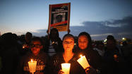 One year later, candlelight vigils for Trayvon Martin