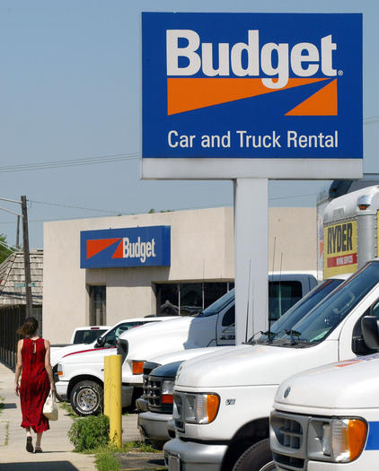 A customer walks towards the Budget car and truck rental office