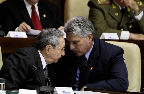 Miguel Diaz-Canel, right, confers with Cuban President Raul Castro at the closing session of the National Assembly in Havana. Diaz-Canel, the country's new first vice president, is seen as the likely successor to Castro.