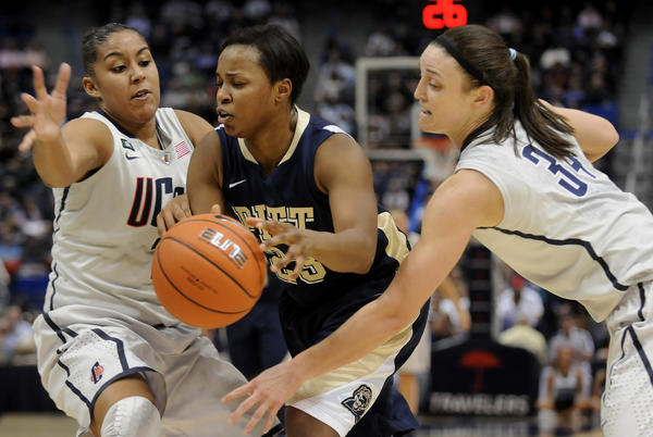 Connecticut Huskies forward Kaleena Mosqueda-Lewis (23) and Kelly Faris (34) trap Pittsburgh Panthers guard Ashlee Anderson (23) during the first half at the XL Center Tuesday night.