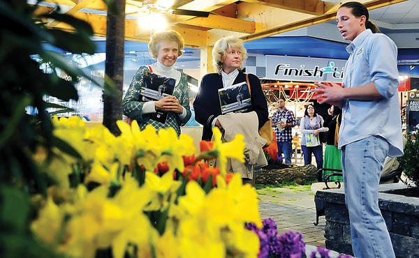 In this March 11, 2012, file photo, Virginia Schmidt, left, and Christa Negley, both of Gerrardstown, W.Va., talk to John Kattwinkel at the R&L Landscapes display at the Eastern Panhandle Home Builders Association's Home Show at the Martinsburg (W.Va.) Mall.