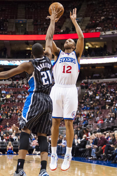 Philadelphia 76ers forward Thaddeus Young (21) shoots as Orlando Magic forward Josh McRoberts (17) defends during the first quarter at the Wells Fargo Center.