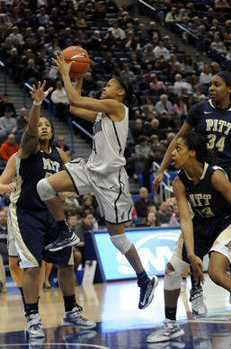 Connecticut Huskies guard Moriah Jefferson (4) drives past the defense of Cora McManus (51), Marquel Davis (13) and Chyna Golden (34) of the Pittsburgh Pathers during the second half. Jefferson had 7 points to help the Huskies to a 76-36 victory at the XL Center Tuesday night.