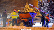 Snowplow overturns on tracks