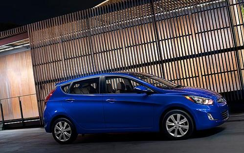 """The 2012 Hyundai Accent is available in both hatchback, above, and sedan versions. The Accent is the latest model to come from a company experiencing a white-hot 2011 in terms of sales. <br> <a href=""""http://www.latimes.com/business/autos/la-fi-autos-hyundai-accent-review-20110818-1,0,6834082.story""""><u>See full story</u></a>"""