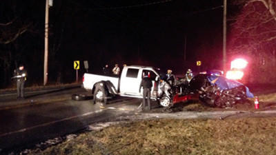 State police investigate a fatal two-vehicle crash Tuesday evening while awaiting the arrival of Somerset County Coroner Wallace Miller. The driver of the SUV on the right died at the scene. The pickup truck's driver was taken to Conemaugh Memorial Medical Center, Johnstown, with undisclosed injuries.
