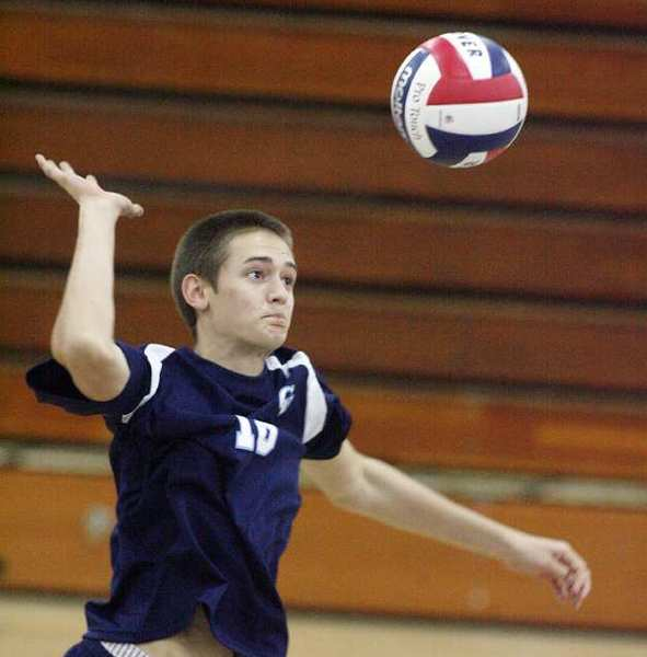 ARCHIVE PHOTO: Crescenta Valley's Freedom Tripp jumps for a kill attempt against Hoover in a Pacific League boys volleyball match.