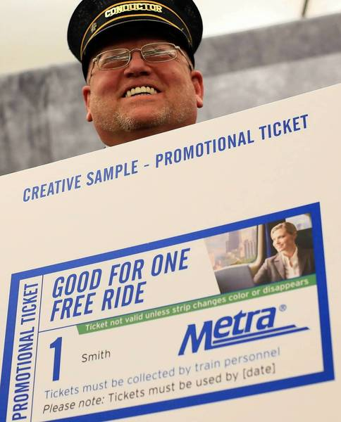 Metra conductor Raymond Sterling shows what a free-ride ticket will look like at a Tuesday news conference. Metra plans to give away 14,000 tickets in the next few weeks.