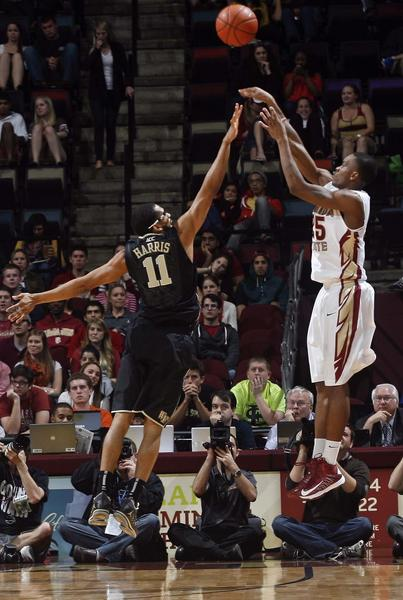 Florida State Seminoles guard Aaron Thomas (25) makes a three-point shot over Wake Forest Demon Deacons guard C.J. Harris (11) in the first half of their game at the Donald L. Tucker Center.