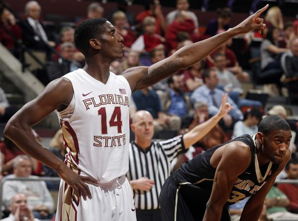 Florida State Seminoles forward Robert Gilchrist (14) points in the first half of their game against the Wake Forest Demon Deacons at the Donald L. Tucker Center.