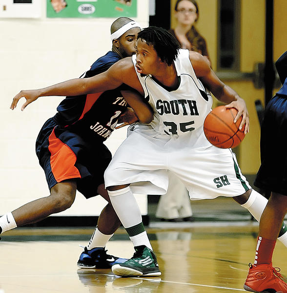 South Hagerstown's Devon King drives to the basket around Thomas Johnson's Temoi Roper in the second quarter Tuesday.