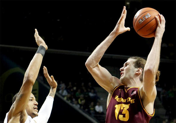 Arizona State's Jordan Bachynski, right, goes up over Oregon's Tony Woods.
