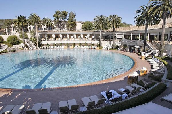 The Coliseum Pool & Grill at Pelican Hill in Newport Beach is 136 feet across and 3 1/2 feet deep. The pool is filled with salt water, which can be heated during times of cooler weather. It took five months to hand lay each of the 1.1 million tiles on the bottom of the pool.