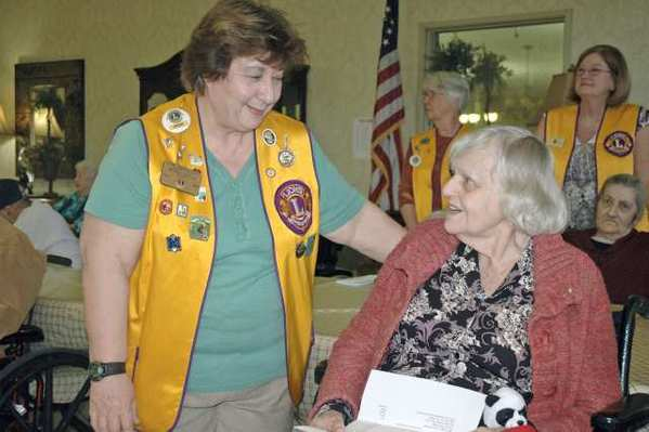 Brenda Lantieri, left, a board member with the Burbank Noon Lions Club, chats with Patricia Beaumont, a resident of the Burbank Healthcare and Rehabilitation Center. The Lions visit the center around the Valentine's Day holiday to let residents know they are remembered.