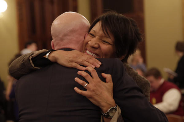 State Rep. Greg Harris, D-Chicago, hugs Daphne Scott-Henderson after passage of the gay marriage bill out of the House Executive Committee to the floor at the State Capitol in Springfield.