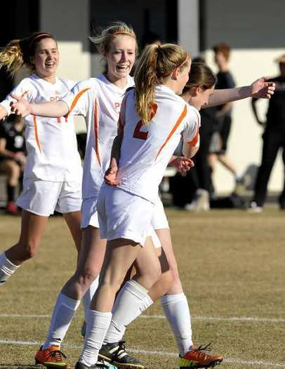 Pasadena Poly's Sarah Mendenhall, left, joins in a celebrations with teammates after Katie Wardlaw scores a go-ahead, penalty-kick goal against Oaks Christian.