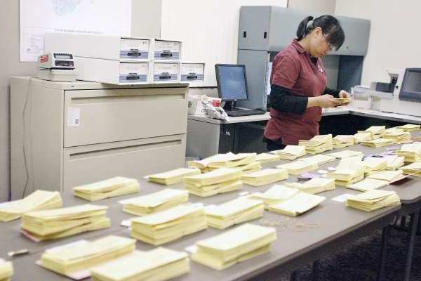 Jocyln Santos sorts out ballots during primary elections, which took place at Burbank City Hall on Tuesday, February 27, 2013.