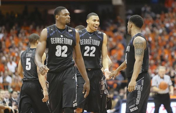 Moses Ayegba (#32), Otto Porter (#22) and D'Vauntes Smith-Rivera, right, of the Georgetown Hoyas celebrate their win over the Syracuse Orange on February 23.