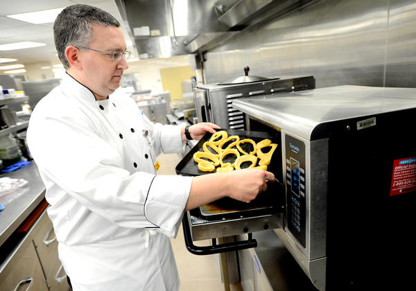 Meritus Executive Chef Joe Fleischman prepares onion rings with a TurboChef oven.