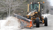 CHICAGO (AP) — A massive, slow-moving storm paralyzed parts of the nation's midsection with heavy, wet snow Tuesday, straining power lines, closing schools, clogging roadways and delaying hundreds of flights before churning eastward, where forecasters expected it to dump 5-8 inches of snow in southeast Michigan on Wednesday afternoon and up to a foot in northern New England by later in the evening.