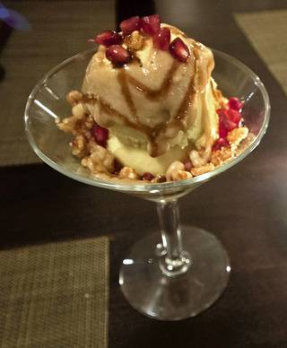 The orange juniper berry creamsicle ($7), is topped with caramel sauce and pomegranate seeds.