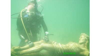 Diver Peter Gillard of Petoskey is seen in this file photo with an underwater crucifix in Little Traverse Bay. The public will be able to view the memorial on Saturday, March 2.
