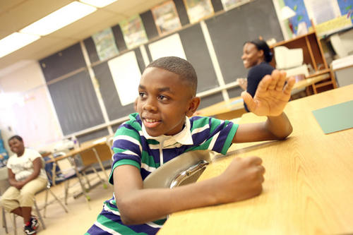 Kendall Rowlett drums a beat in his Hip Hop and Poetry class. Baltimore City's summer school program began with students at Guilford Elementary/Middle participating in a variety of classes this summer including Robotics, Hip Hop and Poetry, and Wide Angle Youth Media.