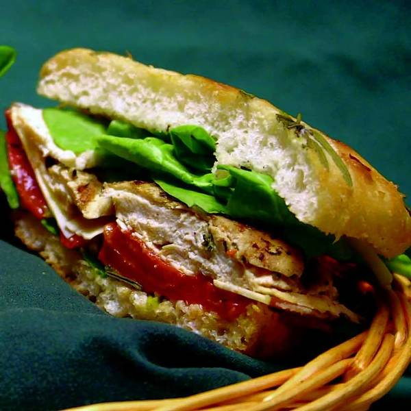 Grilled chicken sandwich with smoked mozzarella, roasted peppers and spinach.
