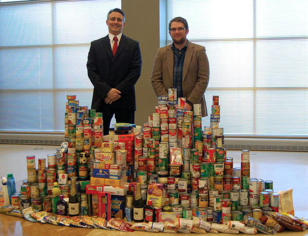 Dr. Leslie Foster, left, and David Bussard of Parkway Neuroscience and Spine Institute in Hagerstown stand among the items collected at the end of 2012 during a food and personal-care item drive organized by Parkway Cares, the Western Branch of the Maryland Food Bank and Wonder Book & Video.