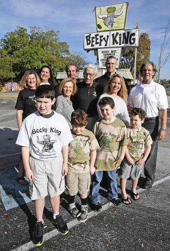 Beefy King family ,Front Row,LtoR, ..Seth Woodrow,11,Jack McGill,7, Trent Woodrow,8, Rhys Woodrow, 5 . 2nd row,LtoR, Terry Smith Kendra Smith, Sandee Smith,Roland Smith, Freeman Smith,James Woodrow, Shannon Woodrow and Bill Fraser in front of their iconic sign Friday, February 22, 2013 for the culinary hall of fame.