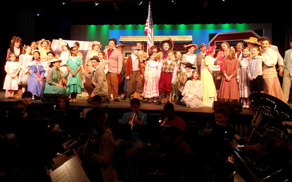 The cast of Easton High Schools' The Music Man anxiously await the Wells Fargo Wagon.