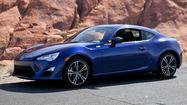 The FR-S is an all-new sports car from Scion, Toyota's youth-oriented brand, and it is fun — holds the road like it's Velcroed to it. And it's not too bad on the wallet, either.