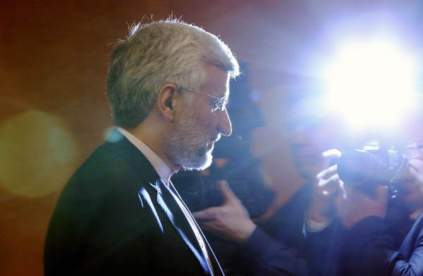 Iran's chief nuclear negotiator Saeed Jalili leaves a news conference in Almaty, Kazakhstan after talks with six world powers.