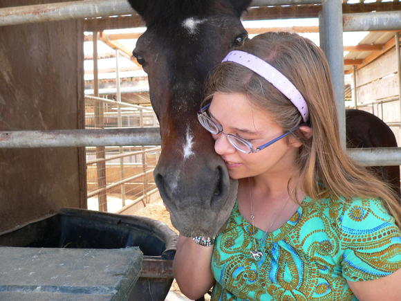 A girl gets close to one of the horses at the Therapeutic Riding Center in Huntington Beach.