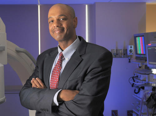"""<B> Neurosurgeon, Mercy Medical Center</b><br> <br> When James L. Frazier was a little boy, growing up in Buffalo, N.Y., his parents had a firm rule: If he wanted to go outside and play, he had to read first. His earliest notions of science came that way, poring over Charlie Brown's Cyclopedia.<br> <br> His mother, a secretary, shouldered the family finances while his father, a Vietnam veteran, struggled with the effects of Agent Orange. Seeing his dad struggling to walk is a lot of what drove him to become a doctor, particularly one most interested in problems of the brain. He wanted to help him.<br> <br> """"The thought was always going through my head, 'Is there any way possible I can remedy this through science or medicine?"""" Frazier says. """"It was another way for me to express my love for him, trying to find a cure.""""<br> <br> Frazier is married with two daughters, ages 5 and 8. The family lives in Owings Mills. He likes to bring the girls into the hospital, hoping to inspire them.<br> <br> As a neurosurgeon, Frazier specializes in brain tumors, spine fractures, degenerative spine disease. There have been blood clots on the brain, large brain tumors, people whose spines are unstable after accidents or falls.<br> <br> He figures he's already operated on about 500 brains, his hands helping to determine if people will be able to walk, move, breathe. A religious man, he likes to think of his hands as instruments of God.<br> <br> One of his favorite parts of the job is stepping out of the operating room after a tough surgery and going to find the family huddled in the waiting room to tell those gathered that it's going to be OK.<br> <br> """"I love the surgical aspects, but I think I get more satisfaction from seeing patients,"""" he says. """"That sense from them that they're putting that trust in me. The gratitude. Just being able to come out and talk to them, calm their fears."""""""