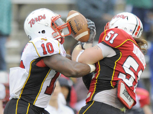Linebacker Ryan Donohue knocks the ball away from running back D.J. Adams during the Red-White game. Adams rushed for 70 yards and two touchdowns in his Terps debut.