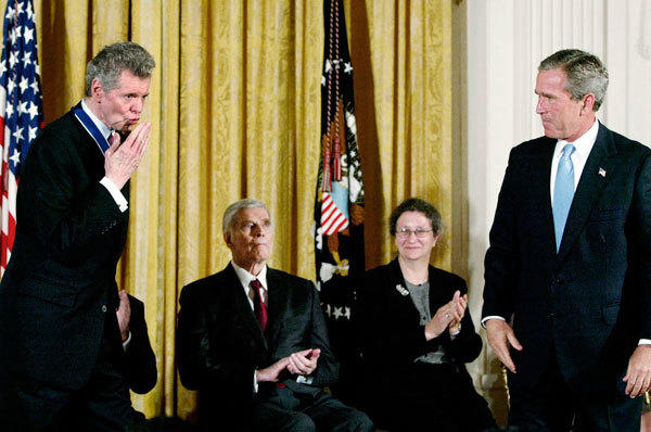Concert pianist Van Cliburn (L) blows a kiss after U.S. President George W. Bush presented him the Presidential Medal of Freedom, during a ceremony in the East Room of the White House, July 23, 2003.