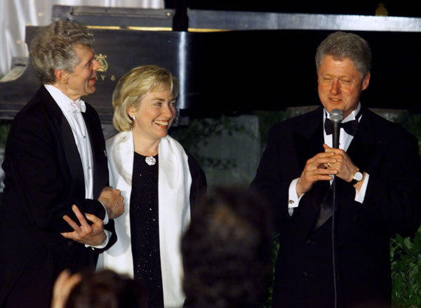 President Bill Clinton and first lady Hillary Rodham Clinton thank pianist Van Cliburn for his performance at the White House, May 3. Cliburn performed at the state dinner in honor of Japanese Prime Minister Keizo Obuchi.