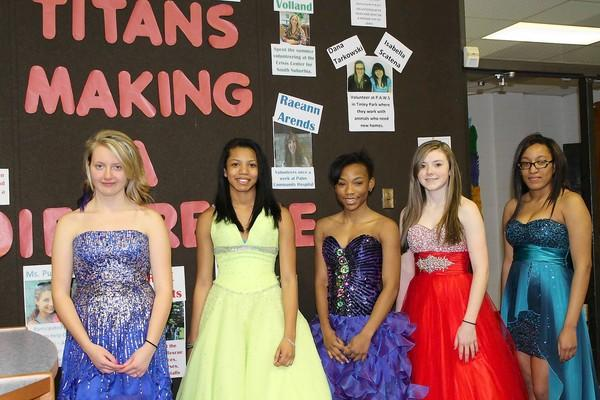 Tinley Park High School freshman Breanna Young, from left, sophomores Aaliayah Banks, Jhamese Willis and Kayle Benoit, and senior Jeffany Booker take a break from studying in the library to model several of the gently-used gowns available at the sale this weekend at the school's Prom Boutique.